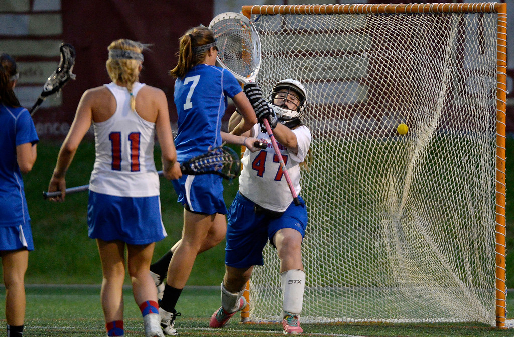 . Centaurus Olivia Holmes (7) finds the back of the net on Cherry Creek goalie Delaney Solomon (47) during their lacrosse state championship game. (Photo By John Leyba/The Denver Post)