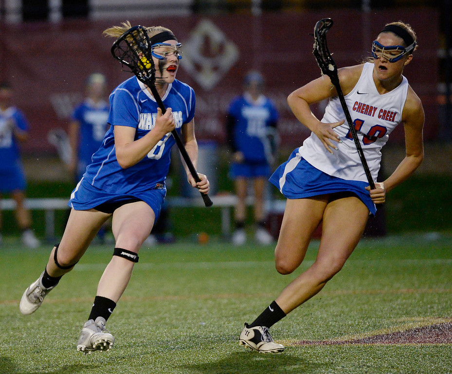 . Centaurus Katerine Burns (18) heads up field with the ball as she gets chased by Cherry Creek Sarah Cromer (18) during their lacrosse state championship game. (Photo By John Leyba/The Denver Post)