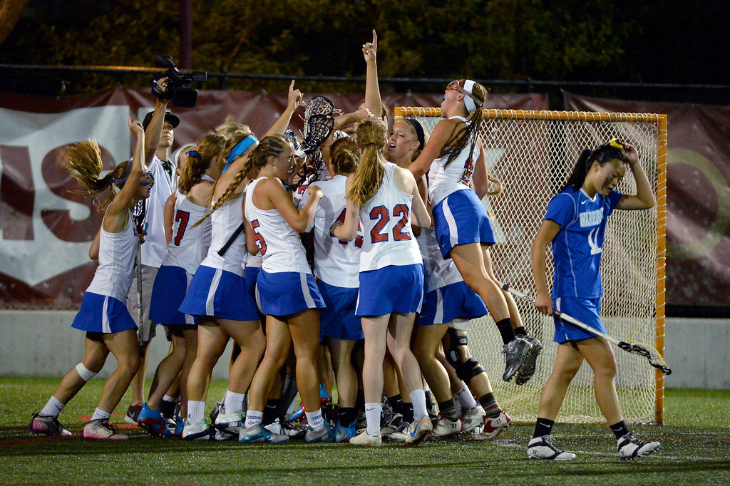. Centaurus Andrea Kim (11) walks past a jubilant Cherry Creek team after defeating them 20-10. (Photo By John Leyba/The Denver Post)