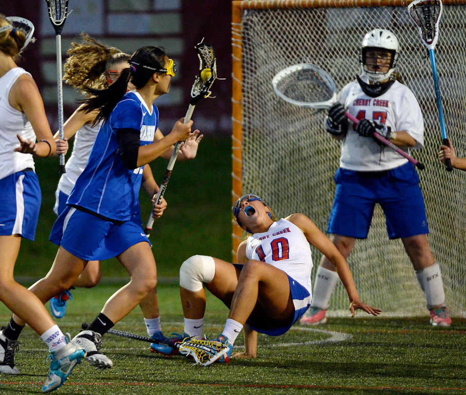 . Cherry Creek Vaia Overhardt (10) goes down with a knee injury Centaurus during their lacrosse state championship game against Centaurus. (Photo By John Leyba/The Denver Post)