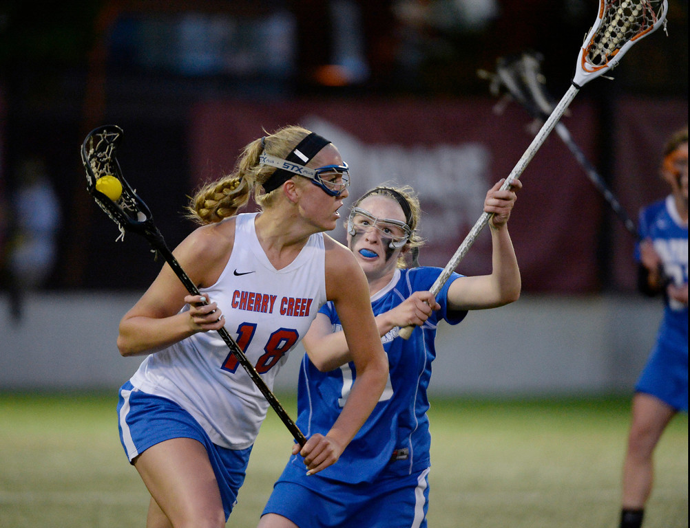 . Cherry Creek Sarah Cromer (18) heads up field as she gets chased by Centaurus Quinn Trudel (13)  during their lacrosse state championship game May 22, 2013 at the University of Denver\'s Peter Barton Lacrosse Stadium. (Photo By John Leyba/The Denver Post)