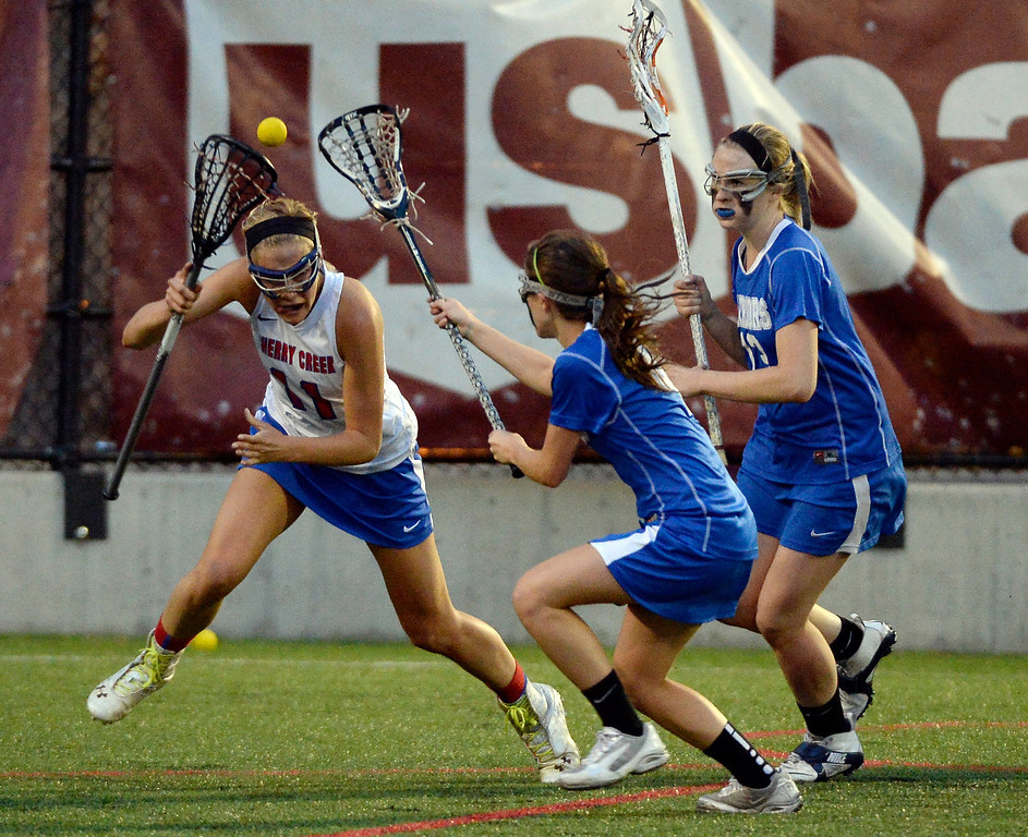 . Cherry Creek Blair Sisk (11) misses he ball in front of Centaurus Avery McGiboney (4) and Quinn Trudel (13) during their lacrosse state championship game. (Photo By John Leyba/The Denver Post)