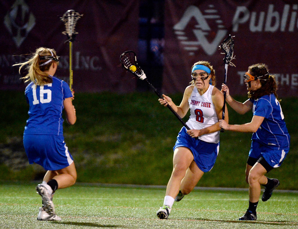 . Cherry Creek Colby Goettelman (8) tries to get past Centaurus Elisabeth Wallace (23) during their lacrosse state championship game. (Photo By John Leyba/The Denver Post)