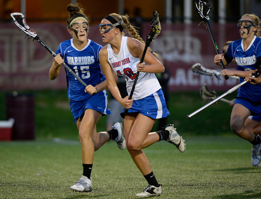 . Cherry Creek Sarah Cromer (18) heads up field as she gets chased by Centaurus Katie Coleman (15) during their lacrosse state championship game. (Photo By John Leyba/The Denver Post)