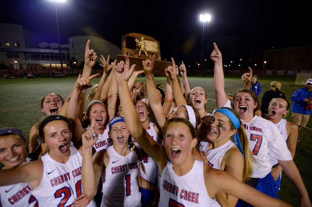 . Cherry Creek lacrosse girls holds up the championship trophy after defeating Centaurus 20-10 during their lacrosse state championship game May 22, 2013 at the University of Denver\'s Peter Barton Lacrosse Stadium. (Photo By John Leyba/The Denver Post)