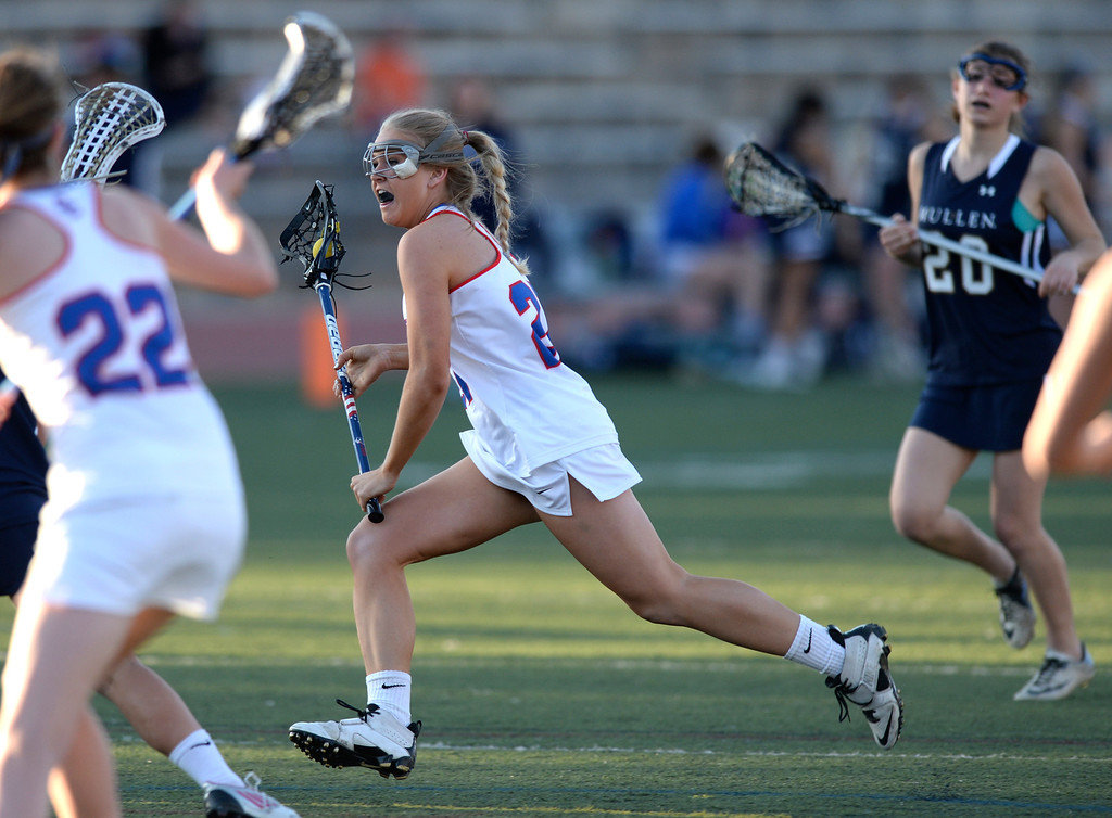 . DENVER, CO - APRIL 9:  Cherry Creek senior attack Annie Dent (27) made a run in the second half. Cherry Creek attack Colby Goettelman had five goals to lead the Bruins past Mullen Wednesday,  April 9, 2014. Creek is the defending girl\'s lacrosse state champion.  (Photo by Karl Gehring/The Denver Post)