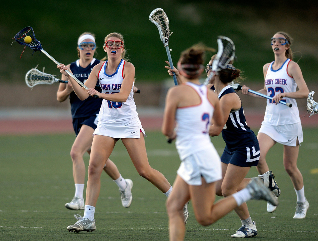 . DENVER, CO - APRIL 9:  Creek midfielder Amy Heider (10) passed the ball up to Olivia List (3) in the second half. Cherry Creek attack Colby Goettelman had five goals to lead the Bruins past Mullen Wednesday, April 9, 2014. Creek is the defending girl\'s lacrosse state champion.  (Photo by Karl Gehring/The Denver Post)