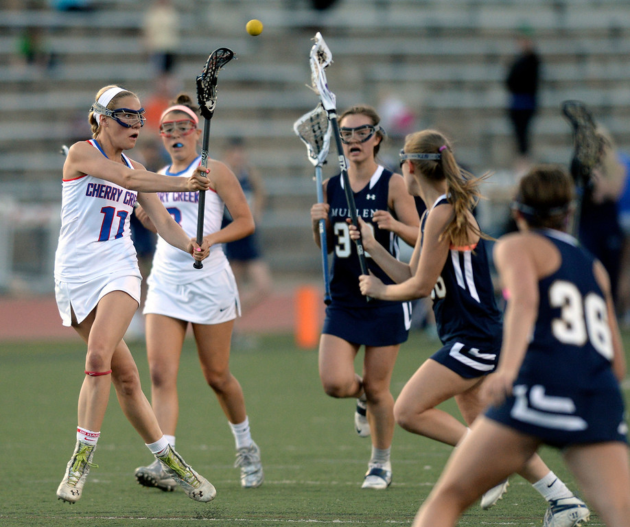 . DENVER, CO - APRIL 9:  Creek midfielder Blair Sisk (11) fed the ball inside late in the second half. Cherry Creek attack Colby Goettelman had five goals to lead the Bruins past Mullen Wednesday, April 9, 2014. Creek is the defending girl\'s lacrosse state champion.  (Photo by Karl Gehring/The Denver Post)