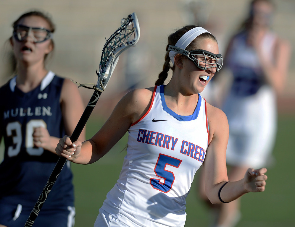 . DENVER, CO - APRIL 9:  Cherry Creek  senior midfielder Nell List celebrated a goal early in the first half. Creek senior attack Colby Goettelman had five goals to lead the Bruins past Mullen Wednesday, April 9, 2014. Creek is the defending girl\'s lacrosse state champion.  (Photo by Karl Gehring/The Denver Post)