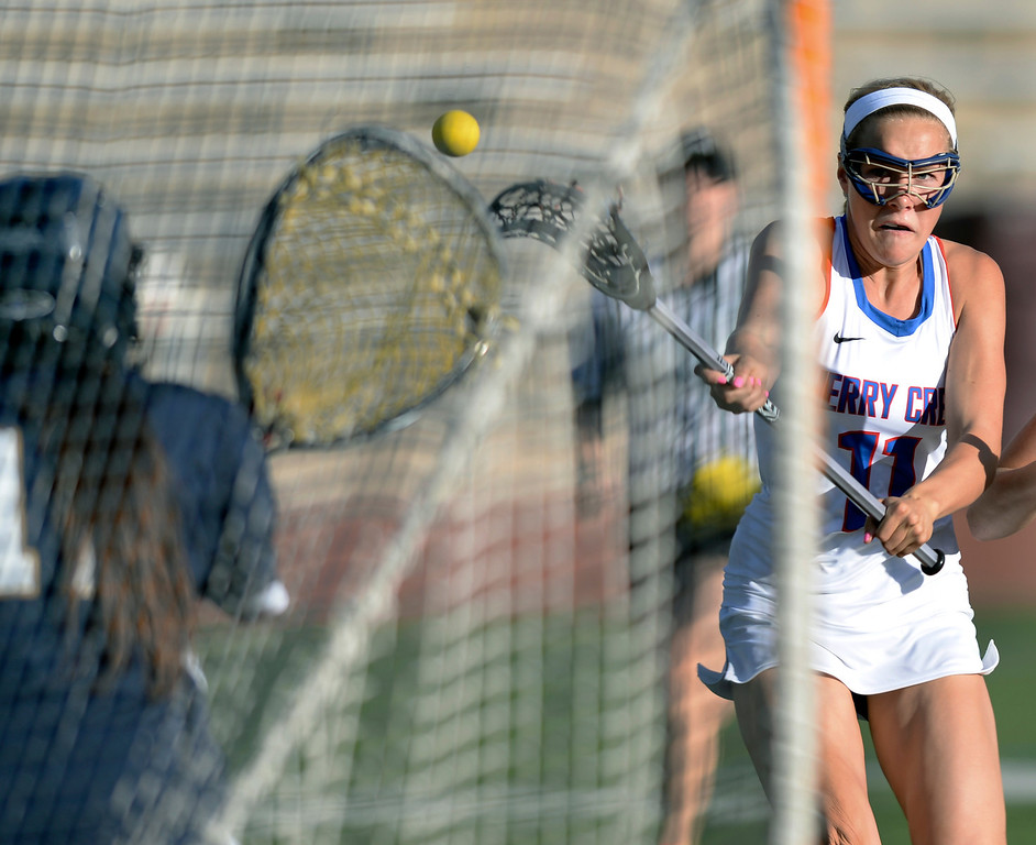 . DENVER, CO - APRIL 9:  Cherry Creek senior attack Blair Sisk (11) put a shot on net early in the first half. Creek senior attack Colby Goettelman had five goals to lead the Bruins past Mullen Wednesday, April 9, 2014. Creek is the defending girl\'s lacrosse state champion.  (Photo by Karl Gehring/The Denver Post)