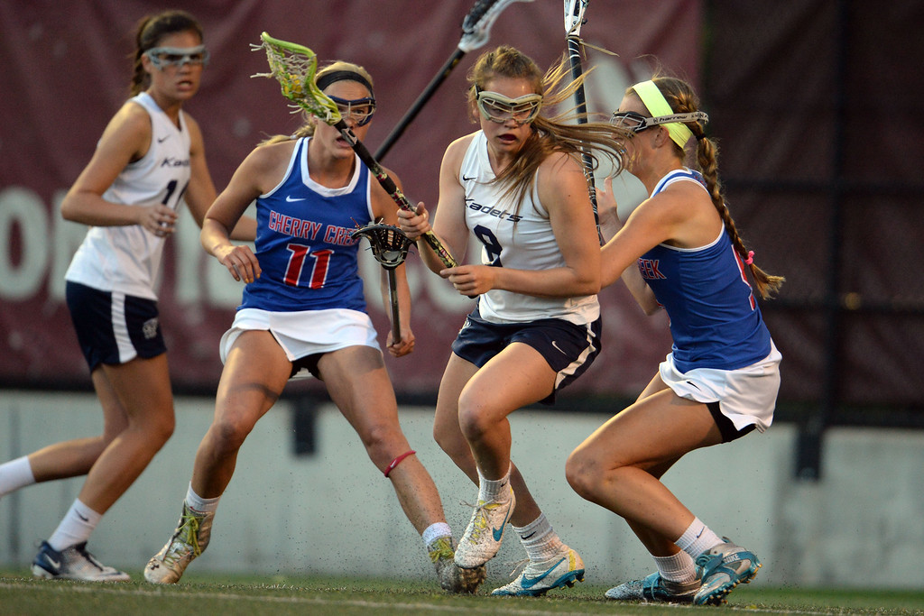 . Maddie Jahelka (8) of the Air Academy Kadets is defended by Nell List (5) of the Cherry Creek Bruins during Academy\'s 11-10 girls 5A championship game win. (Photo by AAron Ontiveroz/The Denver Post)