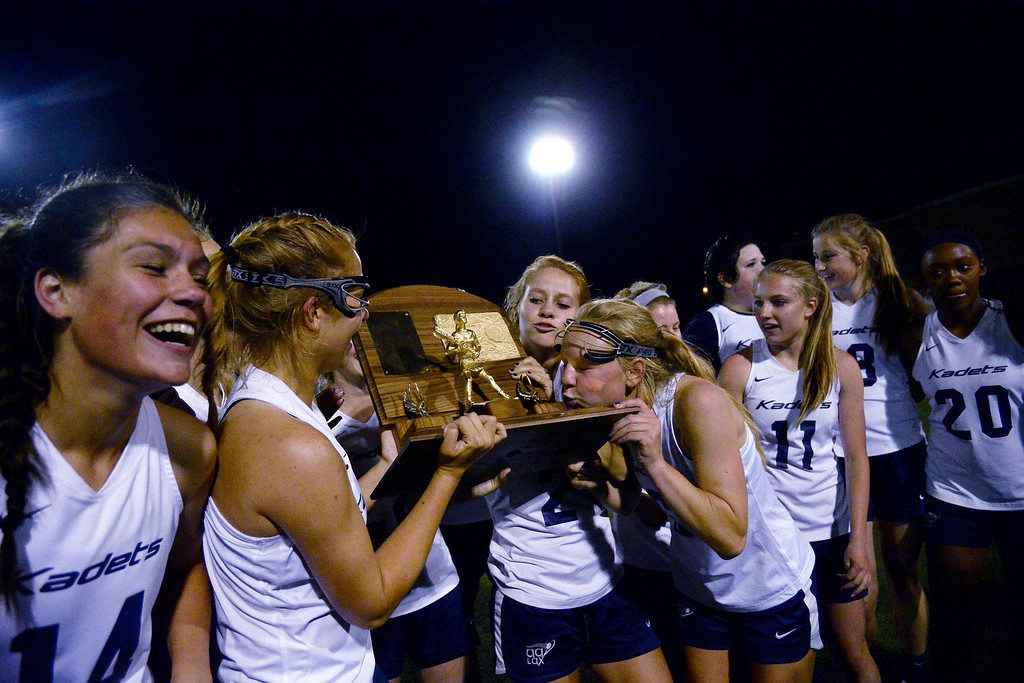 . Natalie Berg (2) of the Air Academy Kadets kisses the championship trophy after Academy\'s 11-10 girls 5A championship game win over Cherry Creek Bruins. (Photo by AAron Ontiveroz/The Denver Post)