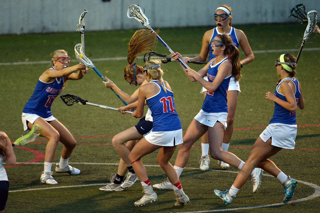 . Emily Trousil (26) of the Air Academy Kadets gets swarmed by the Cherry Creek Bruins defense during Academy\'s 11-10 girls 5A championship game win. (Photo by AAron Ontiveroz/The Denver Post)