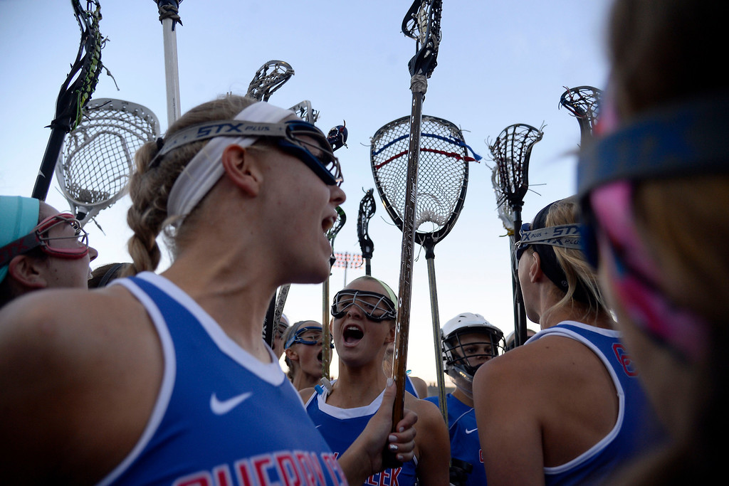 . Cherry Creek Bruins players hype up agains  the tAir Academy Kadets during Academy\'s 11-10 girls 5A championship game win. (Photo by AAron Ontiveroz/The Denver Post)