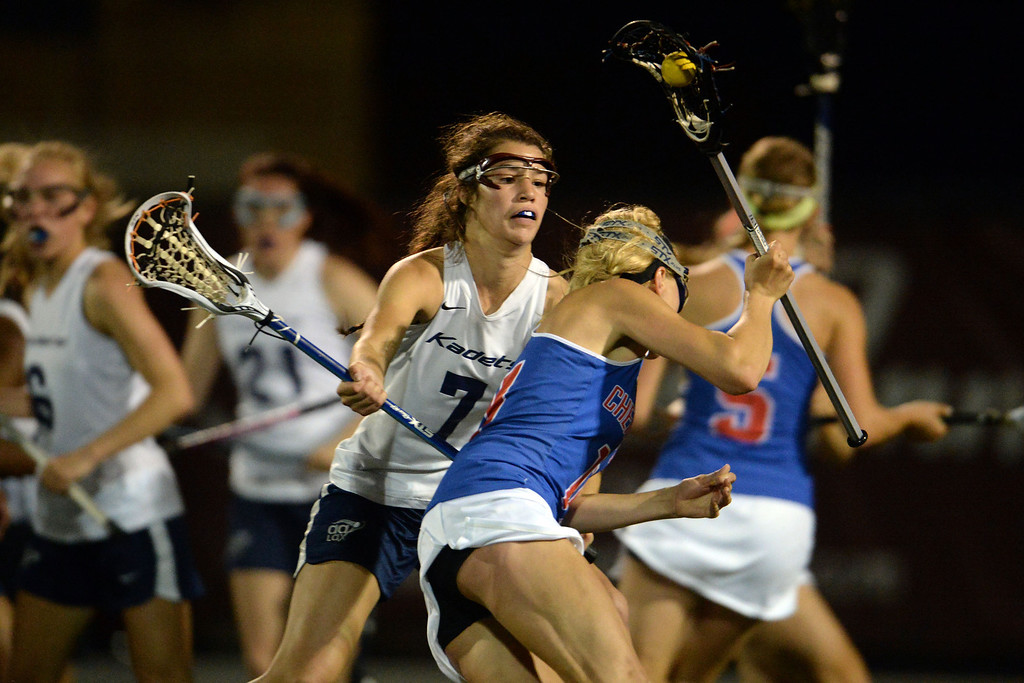 . MacEllen McDonough (7) of the Air Academy Kadets defends Blair Sisk (11) of the Cherry Creek Bruins as she attempts to tie the game during Academy\'s 11-10 girls 5A championship game win. (Photo by AAron Ontiveroz/The Denver Post)