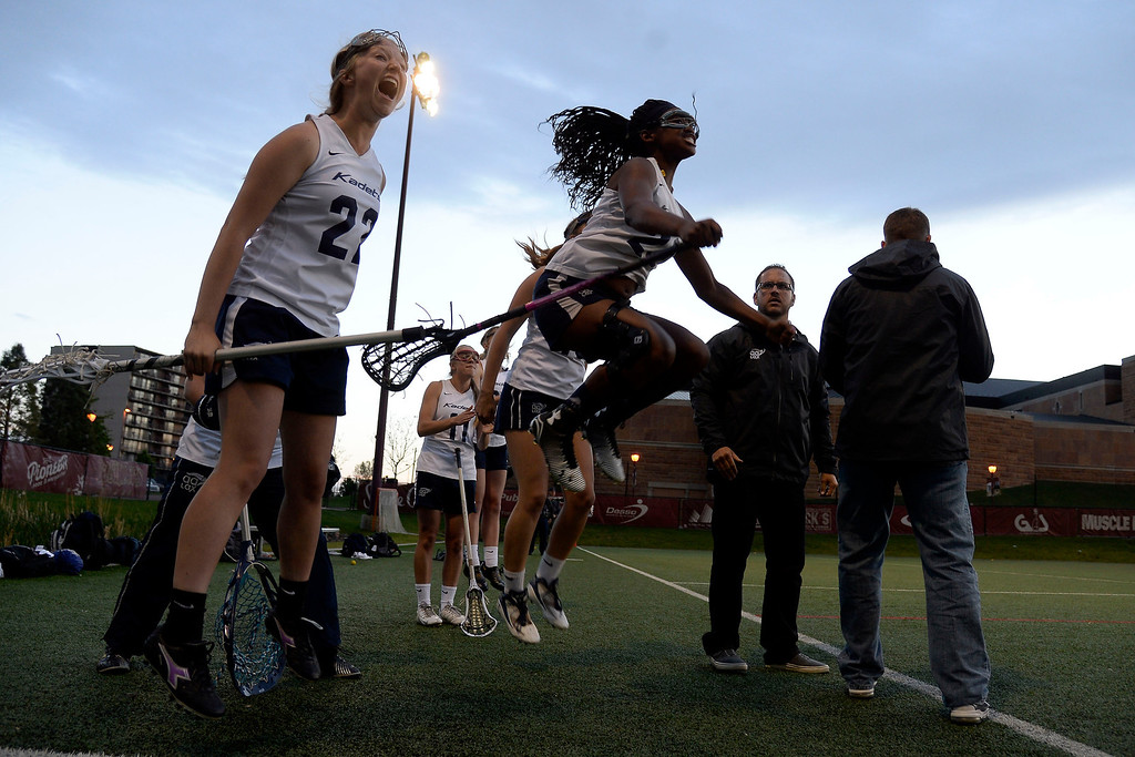. Cierra Mozer (20) of the Air Academy Kadets jumps in celebration with Marlissa Wingett (22) of the Air Academy Kadets after their team scored against the Cherry Creek Bruins during Academy\'s 11-10 girls 5A championship game win. (Photo by AAron Ontiveroz/The Denver Post)