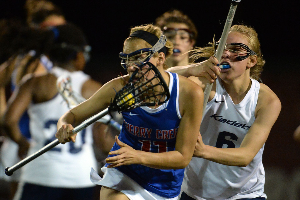 . Katey Holmes (6) of the Air Academy Kadets defends Blair Sisk (11) of the Cherry Creek Bruins as she attempts to tie the game during Academy\'s 11-10 girls 5A championship game win.  (Photo by AAron Ontiveroz/The Denver Post)