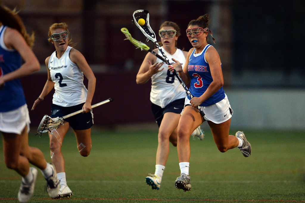 . Olivia List (3) of the Cherry Creek Bruins brings the ball up field against the Air Academy Kadets during Academy\'s 11-10 girls 5A championship game win. (Photo by AAron Ontiveroz/The Denver Post)