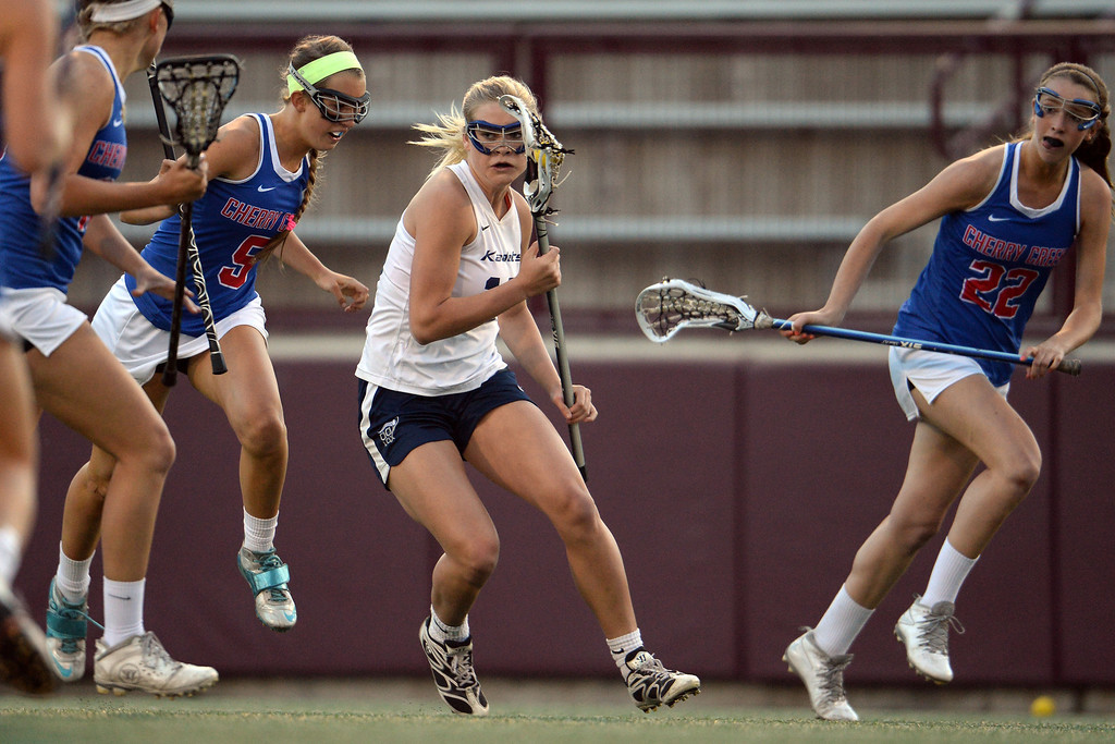 . Taylor Christensen (12) of the Air Academy Kadets controls the ball against the Cherry Creek Bruins defense during Academy\'s 11-10 girls 5A championship game win.  (Photo by AAron Ontiveroz/The Denver Post)