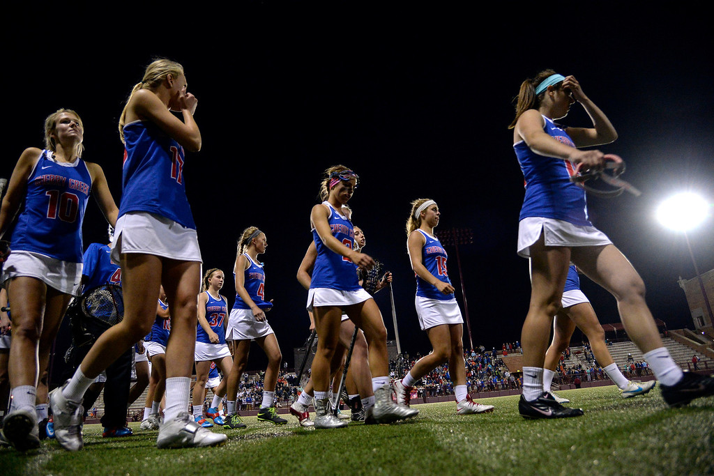 . The Cherry Creek Bruins walk off the field after Air Academy\'s 11-10 girls 5A championship game win. (Photo by AAron Ontiveroz/The Denver Post)