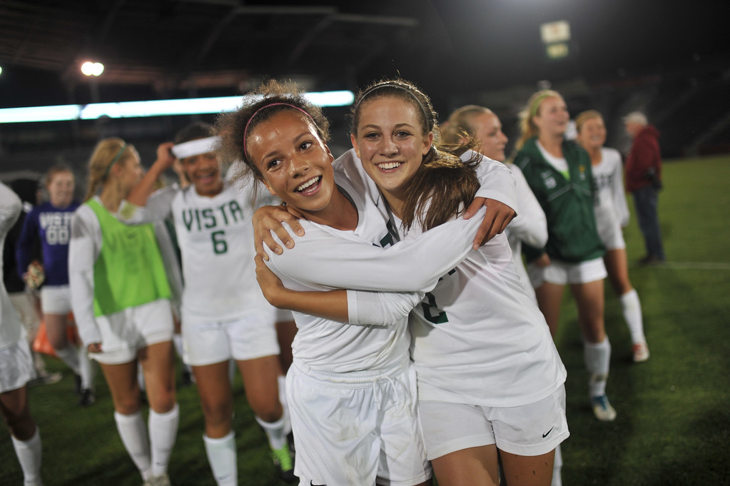 . Mallory Pugh (9), front left, and Kassidy Silva (2) of Mountain Vista High School celebrate their win in the 5A girls soccer championship game against Rock Canyon High School. Mountain Vista won 1-0 in overtime. (Photo By Hyoung Chang/The Denver Post)