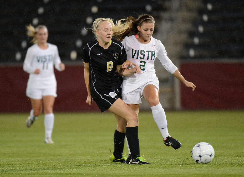 . Kassidy Silva of Mountain Vista High School (2) and Makayla McBride of Rock Canyon High School (8) chase the ball during the 5A girls soccer championship game at Dick\'s Sporting Goods Park. (Photo By Hyoung Chang/The Denver Post)