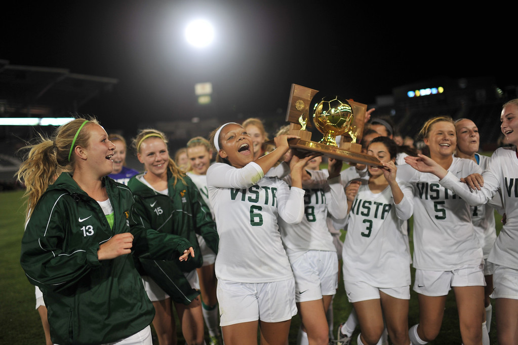 . Peyton Joseph of Mountain Vista High School (6) and the teammates celebrate winning of 5A girls soccer championship game against Rock Canyon High School at Dick\'s Sporting Goods Park. Commerce City, Colorado. May 22, 2013. Mountain Vista won 1-0 OT(Photo By Hyoung Chang/The Denver Post)