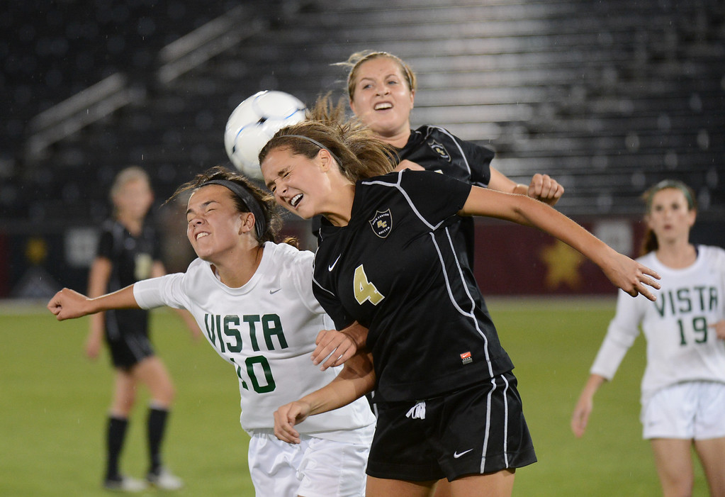 . Megan Massey of Mountain Vista High School (10) and Allie Riggs of Rock Canyon High School fight for control of the ball during the 5A girls soccer championship game. Massey later scored the winning goal to give Mountain Vista a 1-0 victory in overtime. (Photo By Hyoung Chang/The Denver Post)
