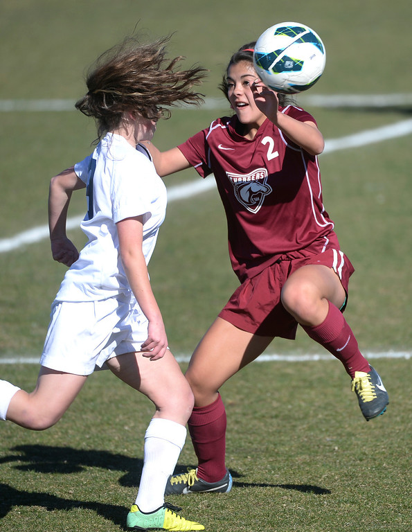 . ARVADA, CO - MARCH 19: Chatfield sophomore Dani DeHart (2) tried to slow down Ralston Valley midfielder Lindsay Guerrero (19) in the first half. The Ralston Valley High School girl\'s soccer team defeated Chatfield 3-2 with an overtime goal by sophomore forward Emma Musson Wednesday evening, March 19, 2014. (Photo by Karl Gehring/The Denver Post)