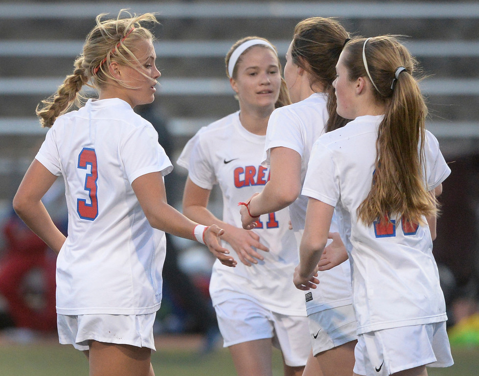. GREENWOOD VILLAGE, CO - MARCH 25: Claire Schrier and Emma Maloney celebrated the Bruin\'s third goal. The Cherry Creek High School girl\'s soccer team defeated Fort Collins 3-2 at the Stutler Bowl Tuesday night, March 25, 2014. (Photo by Karl Gehring/The Denver Post)