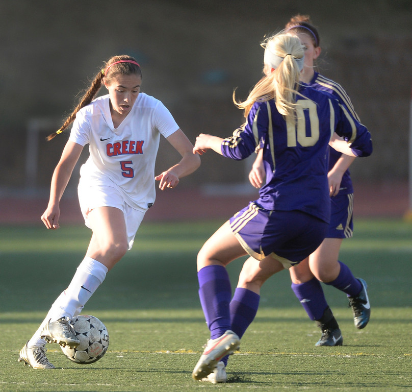 . GREENWOOD VILLAGE, CO - MARCH 25: Creek forward Libby Geraghty (5) dribbled through traffic in the first half. The Cherry Creek High School girl\'s soccer team defeated Fort Collins 3-2 at the Stutler Bowl Tuesday night, March 25, 2014. (Photo by Karl Gehring/The Denver Post)