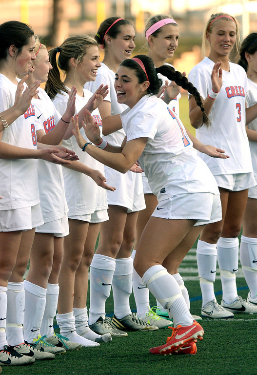 . GREENWOOD VILLAGE, CO - MARCH 25: The Bruins were introduced before the game. The Cherry Creek High School girl\'s soccer team defeated Fort Collins 3-2 at the Stutler Bowl Tuesday night, March 25, 2014. (Photo by Karl Gehring/The Denver Post)