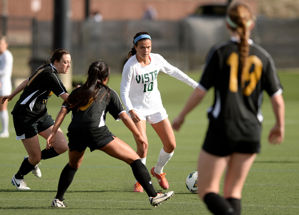 . Megan Massey of Mountain Vista High School (10) controls the ball against Arapahoe High School\'s defense in the first half of the game at Shea Stadium in Highlands Ranch, Colorado on March 29, 2014. Mountain Vista won, 5-4. (Photo by Hyoung Chang/The Denver Post)