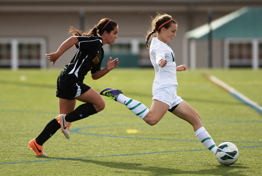 . Katie Joella of Mountain Vista High School (6), right, passes Elena Jauregui of Arapahoe High School (2) to make a goal in the first half of the game at Shea Stadium in Highlands Ranch, Colorado on March 29, 2014. Mountain Vista won, 5-4. (Photo by Hyoung Chang/The Denver Post)