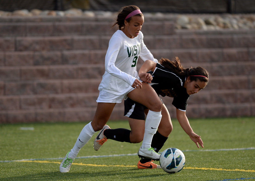 . Mallory Pugh of Mountain Vista High School (9), controls the ball against Elena Jauregui of Arapahoe High School (2) in the second half of the game at Shea Stadium in Highlands Ranch, Colorado on March 29, 2014. Mountain Vista won, 5-4. (Photo by Hyoung Chang/The Denver Post)