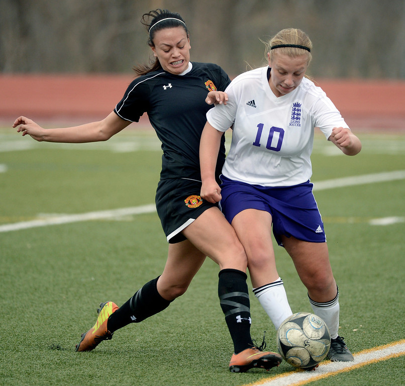. Castle View midfielder Liz Franco (8) challenged Littleton forward Elisabeth Sanson (10) for the ball in the first half. The Littleton High School girl\'s soccer team played Castle View to a scoreless tie Tuesday afternoon, April 1 in Littleton.  (Photo by Karl Gehring/The Denver Post)