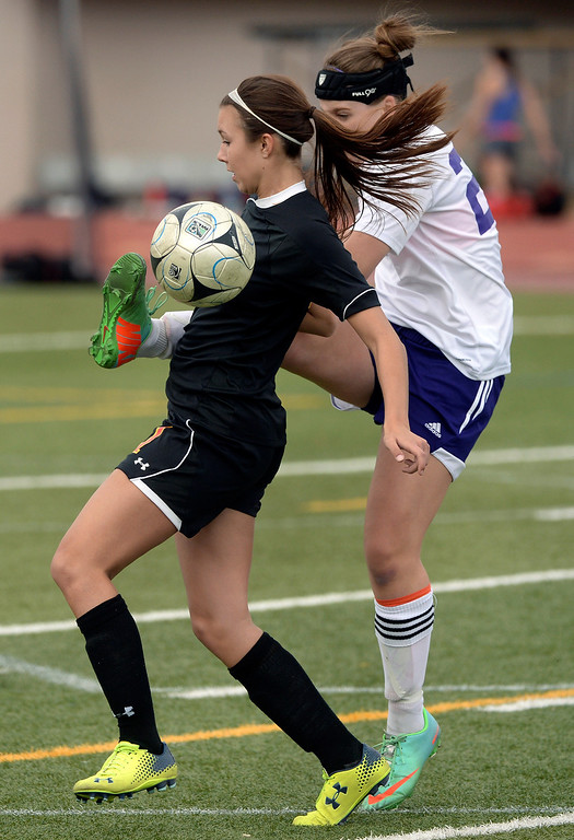 . Littleton junior defender Taylor Hancock (23) tried to clear the ball away from Castle View forward Julie Plonsky (11) in the first half. The Littleton High School girl\'s soccer team played Castle View to a scoreless tie Tuesday afternoon, April 1 in Littleton.  (Photo by Karl Gehring/The Denver Post)