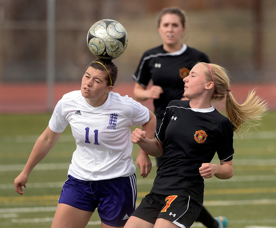 . Littleton junior midfielder Laura Puchino (11) went for the ball with Castle View defender Grace Boyd (7) in the first half. The Littleton High School girl\'s soccer team played Castle View to a scoreless tie Tuesday afternoon, April 1 in Littleton.  (Photo by Karl Gehring/The Denver Post)