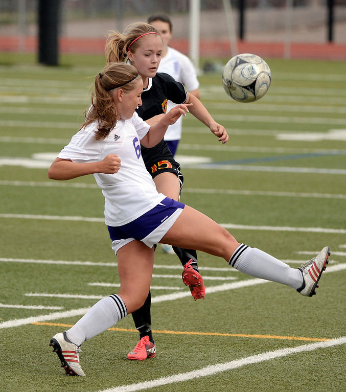 . Littleton senior midfielder Abbey Newby (6) tried to get past Castle View\'s Brandi Bain (15) in the second half. The Littleton High School girl\'s soccer team played Castle View to a scoreless tie Tuesday afternoon, April 1 in Littleton.  (Photo by Karl Gehring/The Denver Post)