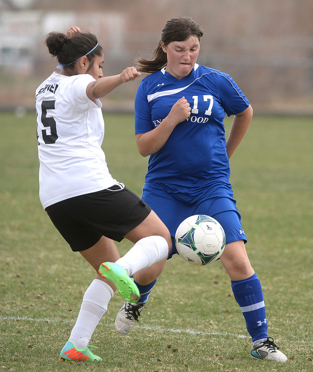 . THORNTON, CO - APRIL 10:  Skyview midfielder Salma Ortiz (15) tried to get past Englewood defender Tori Harris (17) in the first half. The Englewood High School girl\'s soccer team defeated Skyview 1-0 in a 4A matchup Thursday afternoon, April 10, 2014. (Photo by Karl Gehring/The Denver Post)