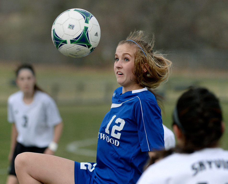 . THORNTON, CO - APRIL 10:  Englewood midfielder Courtney Schuaer (12) went for the ball in the second half. The Englewood High School girl\'s soccer team defeated Skyview 1-0 in a 4A matchup Thursday afternoon, April 10, 2014. (Photo by Karl Gehring/The Denver Post)