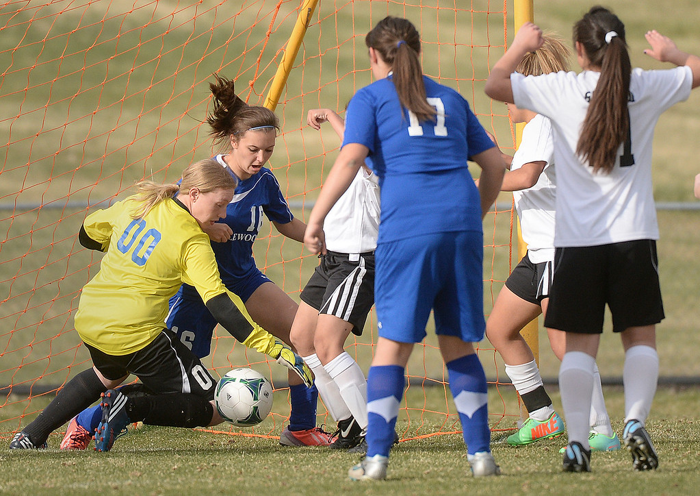 . THORNTON, CO - APRIL 10:  Englewood goalkeeper Miranda Holman dived on a loose ball in front of the net in the second half. The Englewood High School girl\'s soccer team defeated Skyview 1-0 in a 4A matchup Thursday afternoon, April 10, 2014. (Photo by Karl Gehring/The Denver Post)