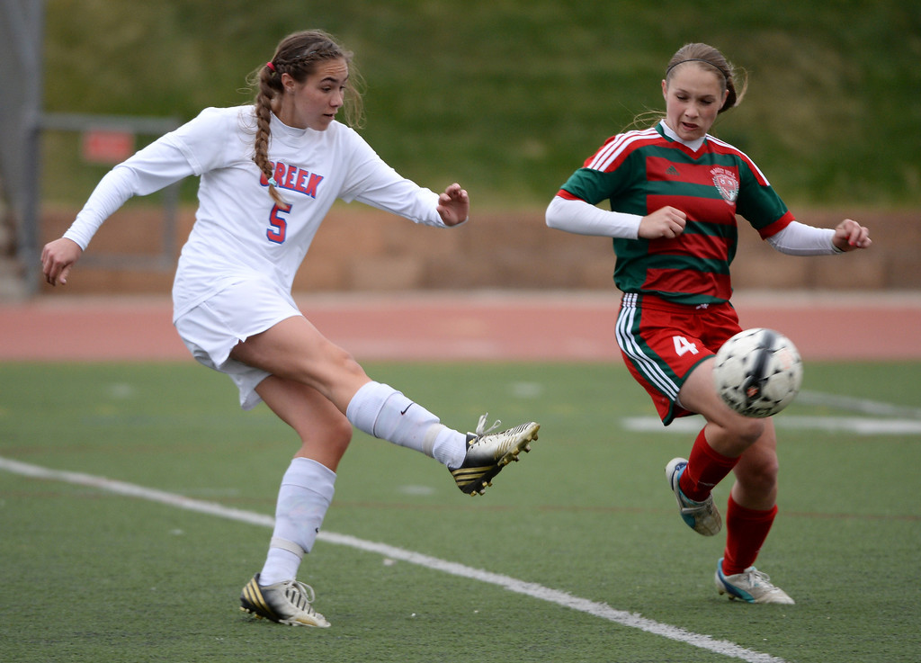 . Libby Geraghty of Cherry Creek High School (5) aims for the goal against Sami Brooks of Smoky Hill High School (4) in the first half. (Photo by Hyoung Chang/The Denver Post)
