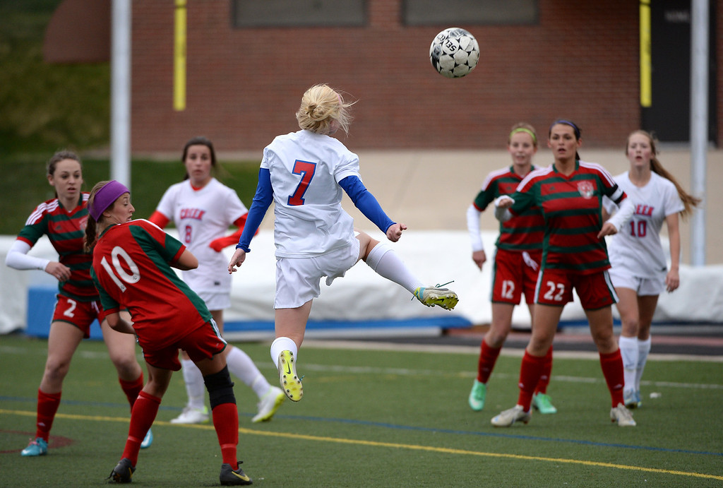. Meg Halvorson of Cherry Creek High School (7), top, does a header to take a shot on goal during the first half against Smoky Hill High School. (Photo by Hyoung Chang/The Denver Post)
