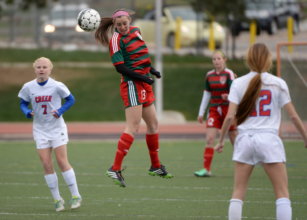 . Brynell Yount of Smoky Hill High School (13) heads the ball during the first half against Cherry Creek High School at Stutler Bowl Stadium in Greenwood Village, Colorado, on Tuesday, April 29, 2014.  Cherry Creek won 3-0. (Photo by Hyoung Chang/The Denver Post)