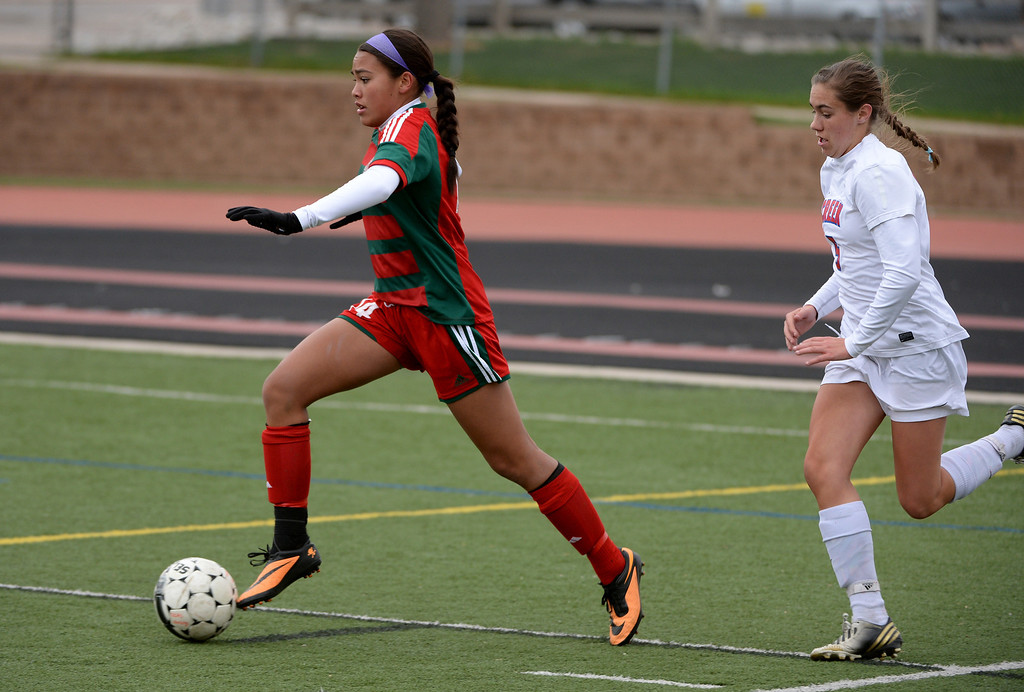 . Britteny Lewis of Smoky Hill High School (14), left, steals the ball from Libby Geraghty of Cherry Creek. (Photo by Hyoung Chang/The Denver Post)