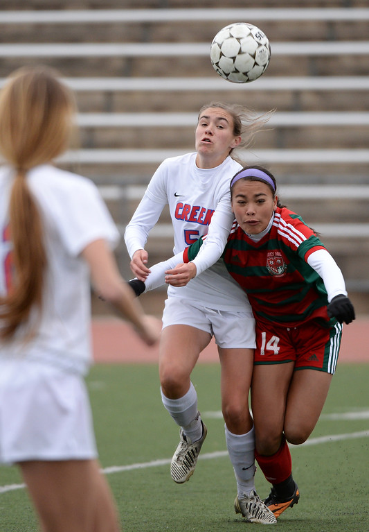 . Britteny Lewis of Smoky Hill High School (14), right, and Libby Geraghty of Cherry Creek High School (5) chase down the ball during the first half. (Photo by Hyoung Chang/The Denver Post)