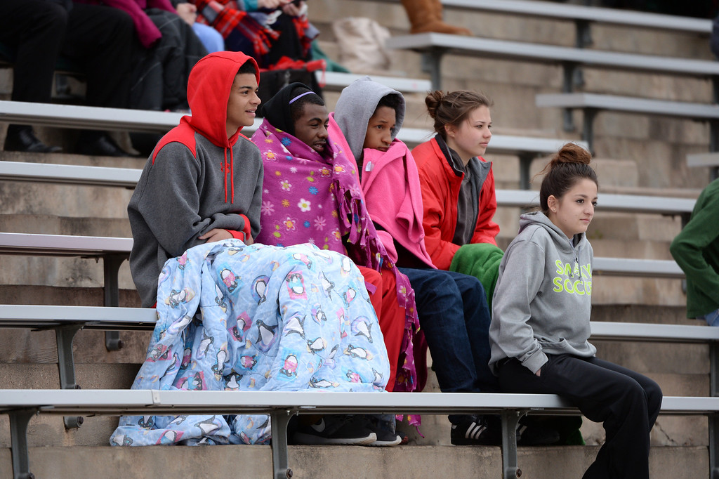 . Smoky Hill High School students cheer their team during the girls 5A soccer game against Cherry Creek High School at Stutler Bowl Stadium in Greenwood Village, Colorado, on Tuesday, April 29, 2014.  Cherry Creek won 3-0. (Photo by Hyoung Chang/The Denver Post)