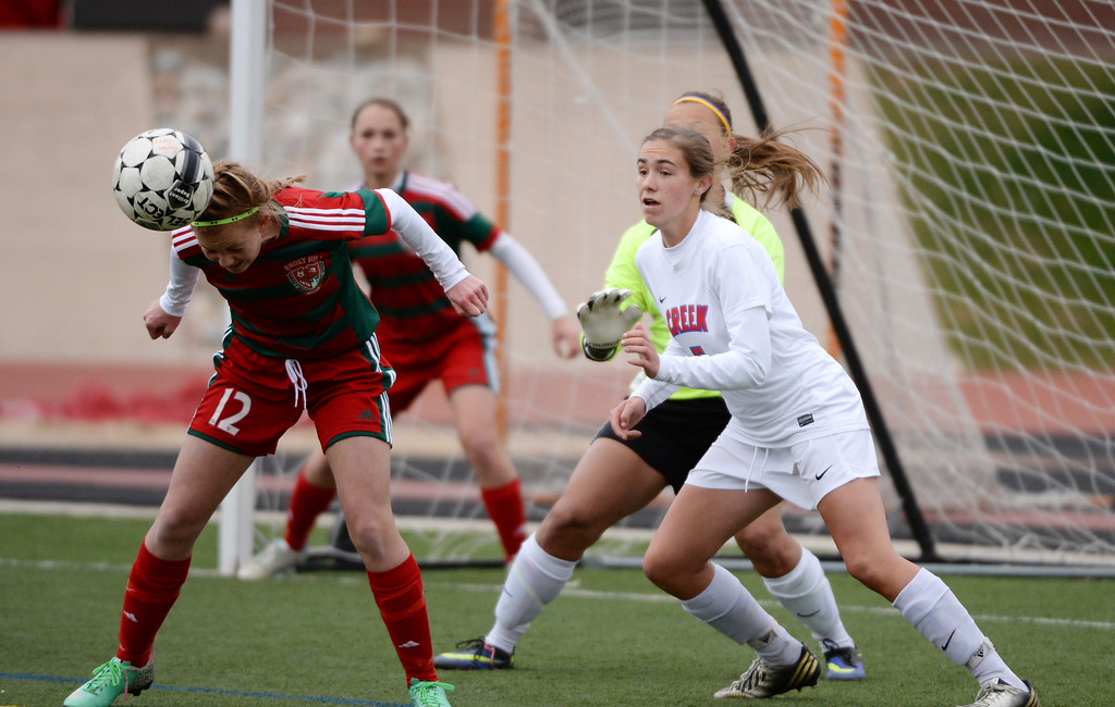 . Emily Goodson of Smoky Hill High School (12), left, defents the goal from Cherry Creek High School offense in the first half. (Photo by Hyoung Chang/The Denver Post)
