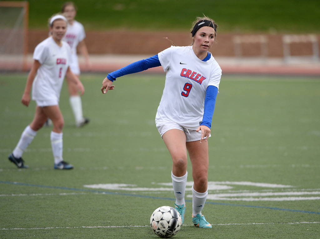 . Katie Haar of Cherry Creek High School (9) runs the ball down field during the first half. (Photo by Hyoung Chang/The Denver Post)
